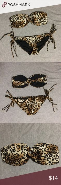 FOREVER 21 Two Piece Bandeau Bikini Set Two piece cheetah print bikini. Never worn. Top is a medium (sorry, my boobs were too big for a small) and bottom is small. Excellent condition. No rips, stains, tears, etc. Selling them both as a set for $14. Forever 21 Swim Bikinis