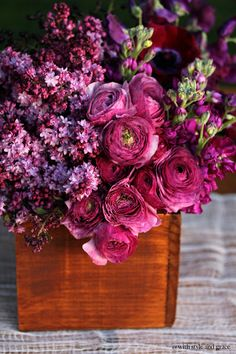 Love the juxtaposition of the elegant ranunculus and stock with the wood container.