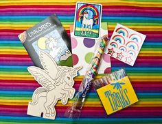 This looks like my childhood. Rainbow stickers! Unicorns! Weird coloring book!