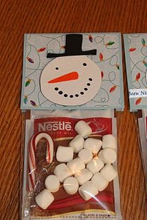 snowman soup: hot cocoa, candy cane, marshmallows