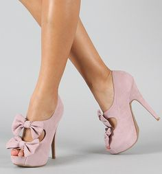 <3 everything about these peep toe bowed heels!