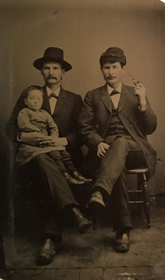 Wyatt and Virgil Earp, with Wyatt holding Virgils Granddaughter. The child is highly likely Maude Bertrand. I can tell you that whoever handed the kid to Wyatt is receiving one hell of a glare from him. Probably Allie made that move. The child looks pretty unhappy as well. 1/6 plate tintype, original image from the collection of P. W. Butler.