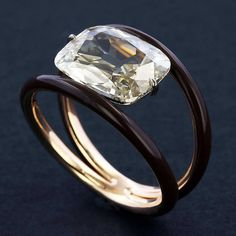 @taffinjewelry • Old cushion cut diamond and ceramic ring.