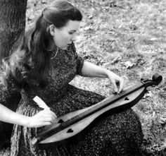 playing dulcimers with feathers I had one of these a friend gave me..God, I wish I still had it!