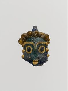 Glass head pendant, Period: Classical, Date: 5th century B.C., Culture: Phoenician or Carthaginian, Medium: Glass; rod-formed, trailed, and tooled