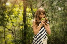 www.frostedproductions.com | #utah #commercial #photographer #striped #dress #pretty #little #girl #flowers #forest #summer