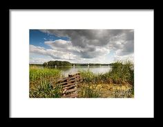 Old bridge and boats at the lake. Green coastal reeds and sailing boats afar, cloudscape in sunny day. Natural landscape in Ruciane-Nida, Masuria, Poland, Europe.  #boat #boats #sailboat #sailboats #waterscape #framedprint #print #homedecor #decor #fineart #prints #lake #landscape #Rucianenida #Poland #Masuria #Mazury