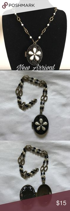 🎉HP🎉Brass/Black/Pearl Handmade Locket Necklace Stunning handmade necklace with brass/black/faux pearls.  The necklace measures about 17 inches and the pendant is 1 1/2 inches.  The pendant stays closed via tiny magnets.  As this is handmade, it can be longer or shorter.  Make an offer today! Sidlee Jewelry Jewelry Necklaces