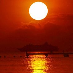 Reflections on a golden pond.  A cruise ship leaves Key West at sunset. Breathtaking!