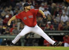 CrowdCam Hot Shot: Boston Red Sox relief pitcher Ryan Dempster pitches during the ninth inning in game one of the American League divisional series playoff baseball game against the Tampa Bay Rays at Fenway Park. Photo by Bob DeChiara