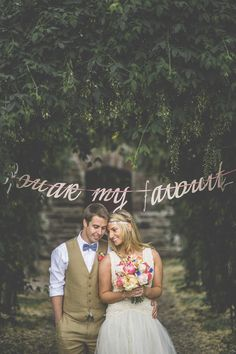 Use your signs to create incredibly memorable photo opportunities. | 40 Awesome Signs You'll Want At Your Wedding