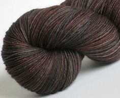 Bfl Sock Yarn Dark Roast hand dyed 75/25 superwash blue-faced-leicester / nylon sock / fingering weight yarn. $21.00, via Etsy.