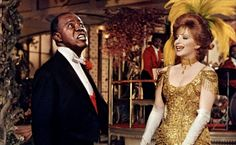 """""""Hello, Dolly!"""" was originally titled """"Dolly, a Damned Exasperating Woman"""" until the producer heard Louis Armstrong's version of the now title song. His recording reached the number one spot on the Billboard Charts in 1964, ending the Beatles' streak of three number-ones in a row! Hear the song on stage at the State Theatre April 4-7! Tickets at www.ecct.org"""