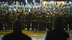 The local police chief resigns in Ferguson, a Missouri town hit by riots over the killing of a black teenager, as two officers are shot during protests.