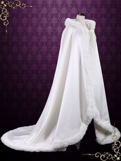 Floor length wedding cloak made with satin and faux fur edge. - Length approx 76 inches from shoulder to edge of train - Photoed in ivory, but can be made in another color or length of your choice.