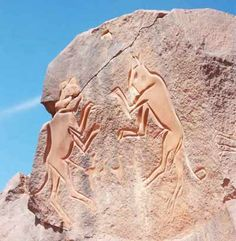 The Fighting Cats: Rock Engraving from Wadi Metkhandoush. Anthropologists have concluded that about 125,000 years ago North Africa. Evidence from this period indicates humans painted their faces with red ochre. While cultural evidence from Fezzan, the home of the classical Libyan Garamantes, the people most scholars hold responsible for some, or much, of Fezann's rock art, goes back to more than 30,000 years.