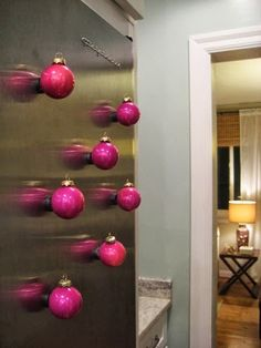 Put magnets on back of ornaments and stick on fridge. cute idea
