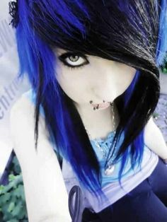 Vibrant blue and black emo hair, canine bites, septum piercing