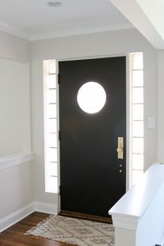 A Black Front Door with Satin Brass Hardware | The DIY Playbook