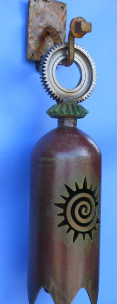 Bell made from railroad parts gears and tanks