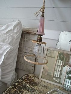 DIY: Broken table lamp repaired & reused as a hanging light! This link explains how she revamps this hanging light.