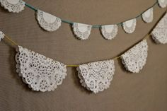 This unbelievably easy DIY is the perfect quick party decor for a tea party! Just choose your doilies, fold them in half around twine or yarn, and tape them down to create a fun and frilly party banner. Doily Garland, Doily Bunting, Doily Art, Garland Ideas, Doilies Crafts, Paper Doilies, Paper Lace, Cute Diy Projects, Diy Wedding