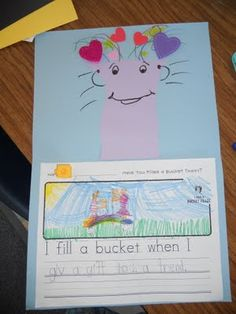 """This is a great way of teaching students what a """"bucket filler is."""" I love the idea of a bucket filler system in a classroom. Bucket fillers build community and make students feel good. Having students write an example of when they are """"filling a bucket"""" is a great way of introducing the idea, especially to a young grade such as 1st."""