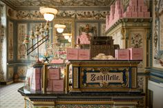 The fictional Mendl's confectionary shop from the film 'The Grand Budapest' by Wes Anderson. The shop was created in a real creamery called 'Pfunds Molkerei' in Dresden Germany, founded by a farmer in (Photograph by Century Fox) Grand Hotel Budapest, Budapest City, Interior Design Inspiration, Color Inspiration, Wes Anderson Color Palette, Wes Anderson Style, Anderson Movies, Grande Hotel, Hotel Paris