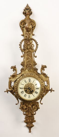 """19th century French Renaissance Revival gilt bronze cartel clock with winged gryphons flanking the clock face, the back plate in the form of a wall bracket with the clock mechanism attached but appearing to be suspended from the bracket, the clock mechanism maker marked """"Trouille A Amiens"""""""