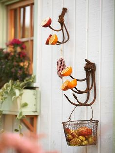 Cast-off cultivator tines are perfect perches for a host of summer bird treats. Oranges, apples, and a mesh bag filled with sour cherries beckon birds. When the season for fresh fruit passes, dangle suet cakes and protein-packed peanut-butter-filled pinecones from the curved tines.