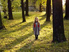 Katrina Tang Photography for Xenia Joost design AW 12 campaign.  Girl standing outdoors in sunshine, park #katrinatang #tangkatrina