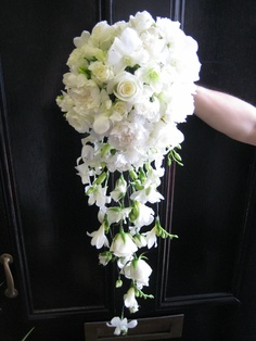 Wired shower bouquet of white singapore orchids, roses, freesias and carnations.
