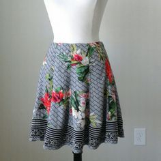Floral mixed print flirty flare  skirt Sits at waist, invisible side zip with hook and eye closure, fully lined,  100% rayon,  waist 32 inches, length 18.75 inches White House Black Market Skirts A-Line or Full