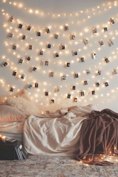 Frameless Photos / Personalize classic string lights by hanging your favorite photos. Wrap the wire around nails or thumbtacks to suspend the lights. When you've found your shape, hang the images by clipping mini clothespins over the wire.
