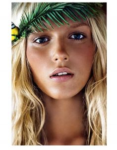 "Try a ""barely there"" look with natural hues for beach ready makeup."