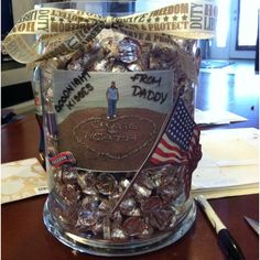 """My husband deployed for 230 days. We have 3 kids so we put 690 Hersey kisses in a vase so each of our kids can get a """"goodnight kiss from daddy"""" each night. It helps them to see when he is getting close to coming home!!!!!!"""