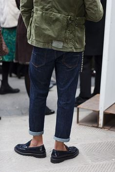 Amazing mix of preppy (shoes; small cuff; fit of jeans) and casual edge (the rough, messy look of the military-inspired jacket; chain hooked to his jeans). Inspiring. #loaferscanbesexy #yourjeanssayitall #military