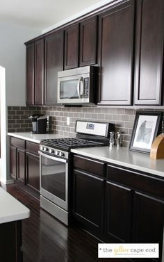 Grey Tile Backsplash White Countertops Cherry Cabinets