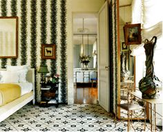 Mentor Madeleine Castaing's rug and on fabric covered walls. Parisian chic.