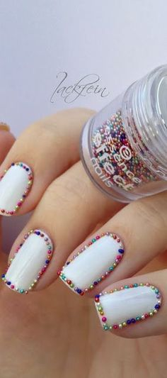 white nails with colourful 3d nail pearls
