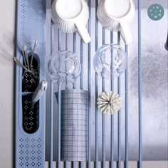 Our Five Two Drying Rack rolls out, fits over sinks of all sizes, and stows away in seconds.