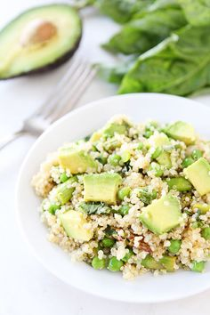 quinoa salad with asparagus, avocado, peas, and lemon basil dressing.