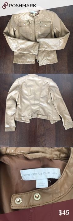 New York & Company Faux Leather Jacket Trendy tan faux leather jacket from New York & Company.  Jacket has gold hardware and elbow pad detail.  Size is XS. There is a small nick in the fabric on the sleeve, shown in 4th photo.  Definitely not noticeable at all. New York & Company Jackets & Coats