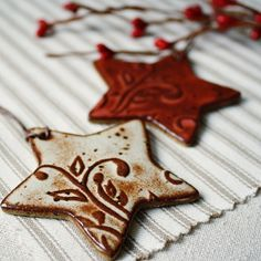Use rubber stamps in salt dough to make ornaments. Salt dough recipe::   2 cups flour, 1 cup salt, cold water. Mix until has consistency of play dough. Bake at 250 for 2 hours.  Cool and paint.