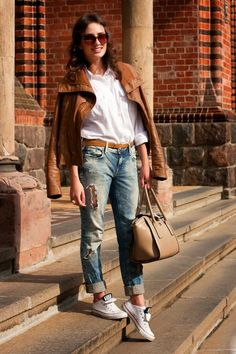 Shop this look on Lookastic: http://lookastic.com/women/looks/low-top-sneakers-sunglasses-dress-shirt-boyfriend-jeans-satchel-bag-jacket-belt/4750 — White Low Top Sneakers — Brown Sunglasses — White Dress Shirt — Blue Ripped Boyfriend Jeans — Tan Leather Satchel Bag — Tobacco Leather Jacket — Orange Leather Belt