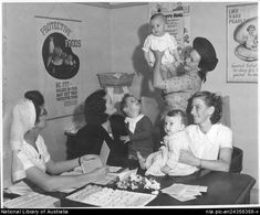 Mothers and babies at the Drouin Infant Welfare Centre, Victoria. Part of the Drouin town and rural life during World War II collection at the National Library of Australia.