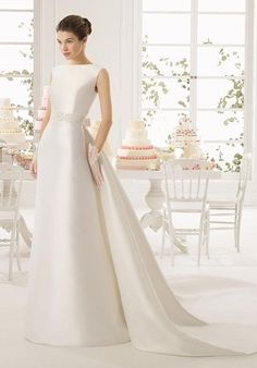 Mikado dress and train with beaded belt in a natural colour.
