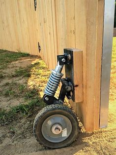 Fence gate wheel w shock Backyard Projects, Outdoor Projects, Home Projects, Backyard Ideas, Garden Ideas, Shed Plans, Garden Gates, Outdoor Living, Home Improvement