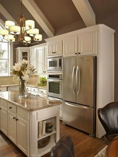 Like: hard wood floors, white (French White?) cabinetry with the gold/brown granite counters, (really like this color combo) shelves on the end of the bar, stainless appliances, height of stove & microwave seems very functional for tall person like me. Chandelier and wall color are okay...