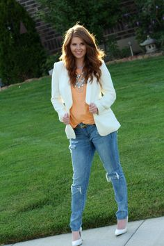 A chic modest way to wear distressed jeans with a peach tee and white blazer. Top off the look with a pair of white heels and gorgeous layered statement necklace.